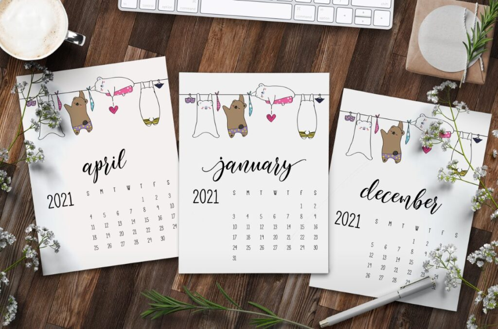 Set of three 2021 calendars with cute animals on washing line with text overlay