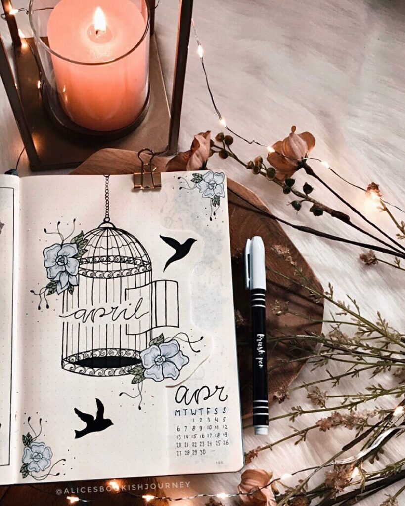Birds and Cage April Bullet Journal Cover Idea
